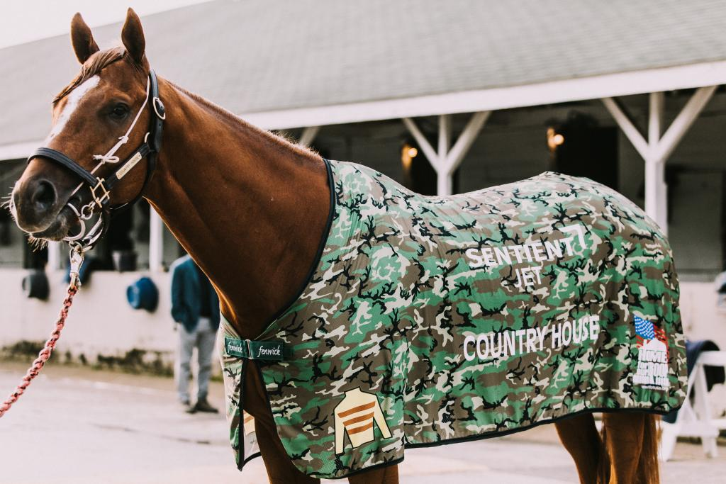 Country House in his custom Homes for Our Troops blanket. (Photo courtesy of Sentient Jet)