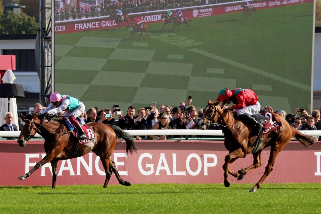 Enable and Frankie Dettorie take the late lead in the Qatar Prix de l'Arc de Triomphe, with Waldgeist rallying behind her. (Eclipse Sportswire)