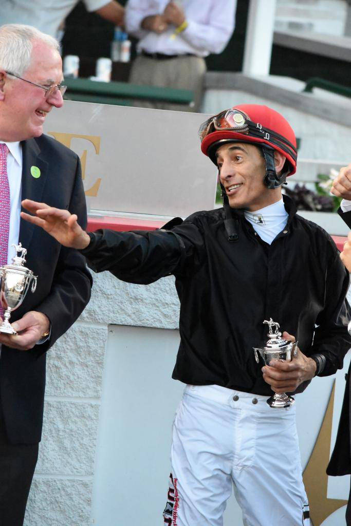 Velazquez then received his trophy and had to book it back to the jockeys' room to change silks for the next race. His expression when asked if he wanted to hand back the trophy for safekeeping instead of taking it back to the jockeys' room was hilarious. (Melissa Bauer-Herzog/America's Best Racing)