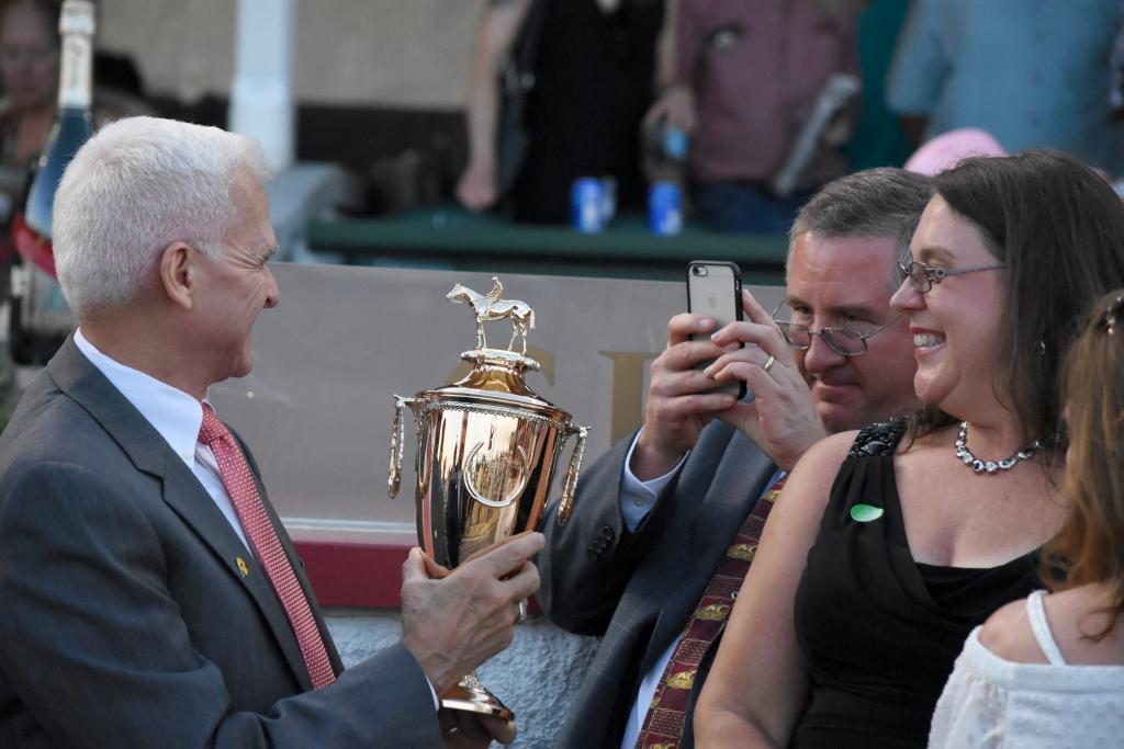 When the ownership group got the winning owners' trophy, the cell phones came out as everyone took turns taking a picture with the trophy. I think about 20 people had their hands on the trophy in a 30 second period. (Melissa Bauer-Herzog/America's Best Racing)