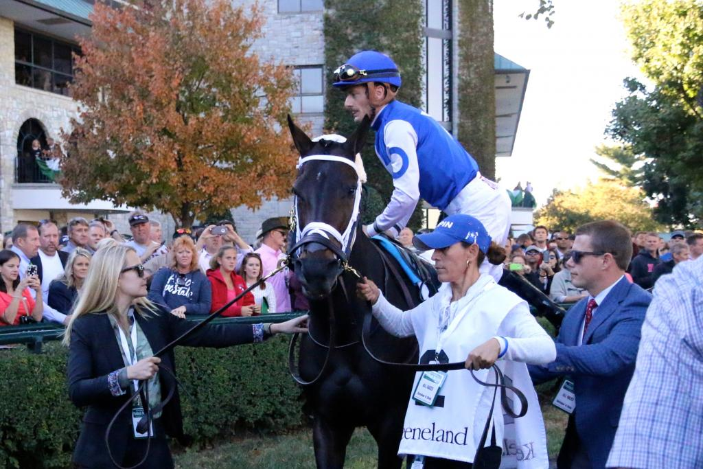 After parading in the walking ring for a few minutes, assistant trainer Norm Casse gave jockey Julien Leparoux a leg up into Tepin's saddle, and then the group headed toward the track to warm up for the First Lady. (Penelope P. Miller/America's Best Racing)