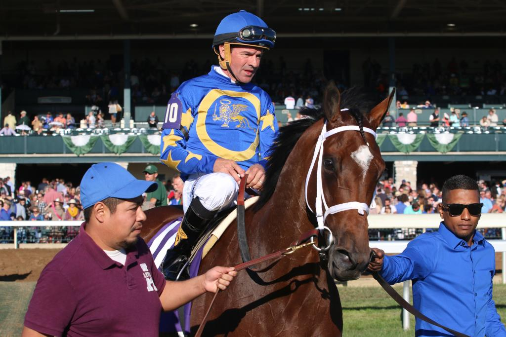 Jockey Kent Desormeaux looked justifiably proud of himself as he rode Photo Call to the winner's circle; after all, his strategy of heading to the front and snatching an easy lead had paid off royally in the First Lady! (Penelope P. Miller/America's Best Racing)