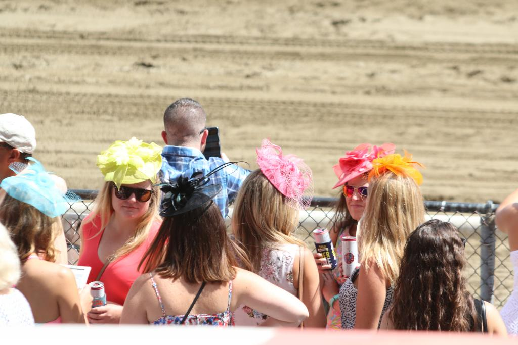 There was some serious style on display, too: I love these ladies' bright fascinators, which are a perfect summertime topper for the races. (Penelope P. Miller/America's Best Racing)