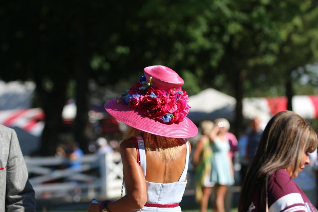 This hat was one of my favorites of the afternoon. It was a total showstopper and a statement piece, but it also blended beautifully with both the rest of her look and the venue of Saratoga. (Penelope P. Miller/America's Best Racing)