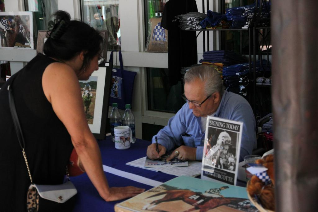 Even Hall of Fame jockey Ron Turcotte, who rode the mighty Secretariat to his Triple Crown victory, was out signing autographs in support of off-the-track Thoroughbreds. (Penelope P. Miller/America's Best Racing)