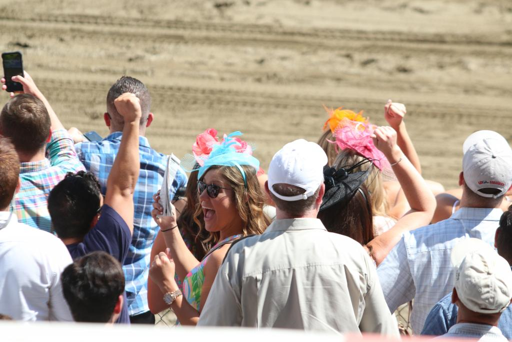Around the track, people were connecting to the horses present in so many different ways. Some fans were celebrating winning tickets on longshot horses.   (Penelope P. Miller/America's Best Racing)