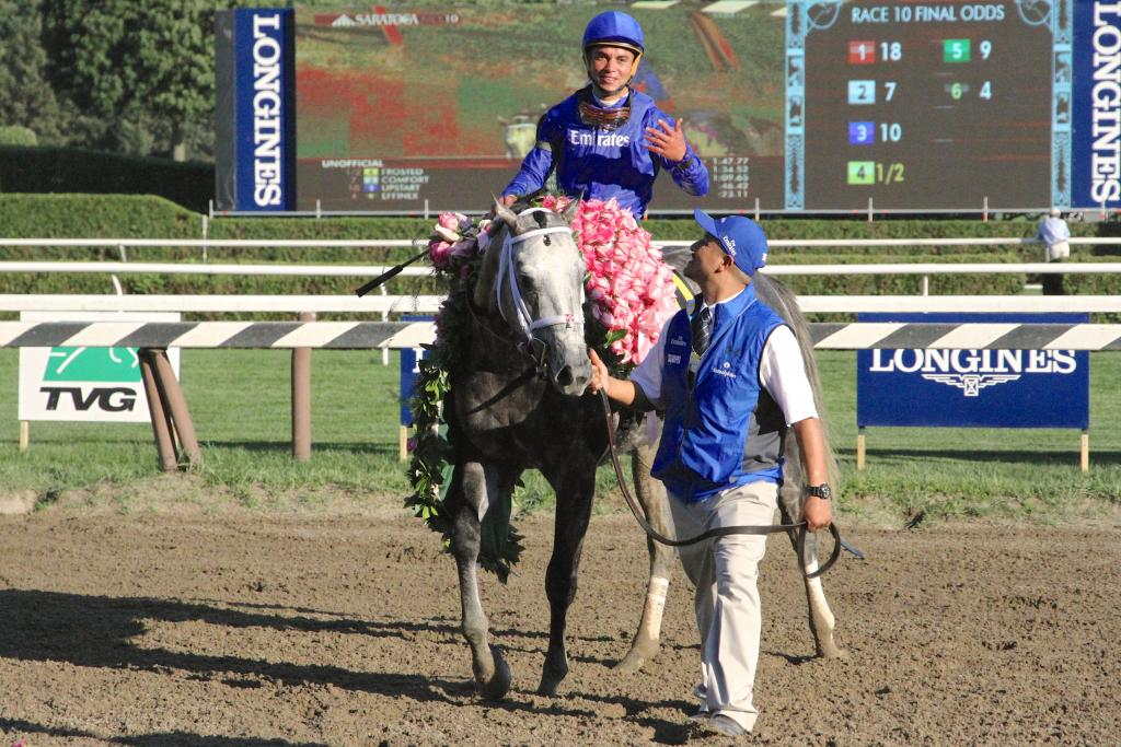 Moments later, Frosted donned the signature pink blanket of Marylou Whitney roses and headed into the winner's circle.  (Penelope P. Miller/America's Best Racing)