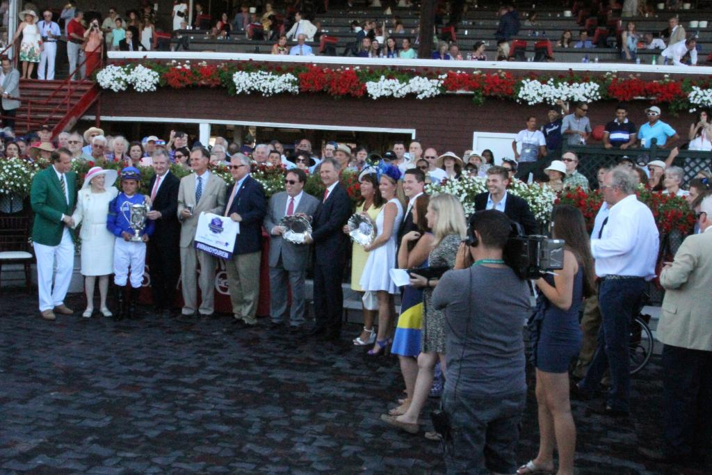 Marylou Whitney was resplendent in white for the winner's circle presentation, making an already fabulous Whitney Stakes day at the Spa complete.