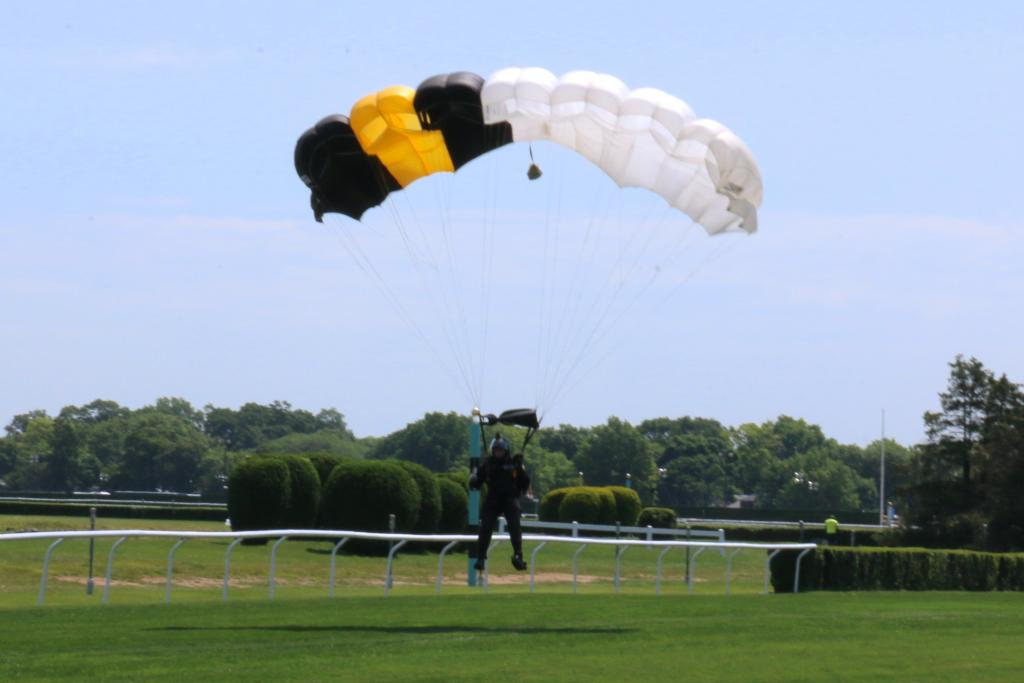 Between races, Belmont put on some pretty spectacular shows, including the Black Knight parachute team. They jumped from a helicopter at dizzying heights to land on the turf course to the delight of the assembled crowd. (Penelope P. Miller/America's Best Racing)