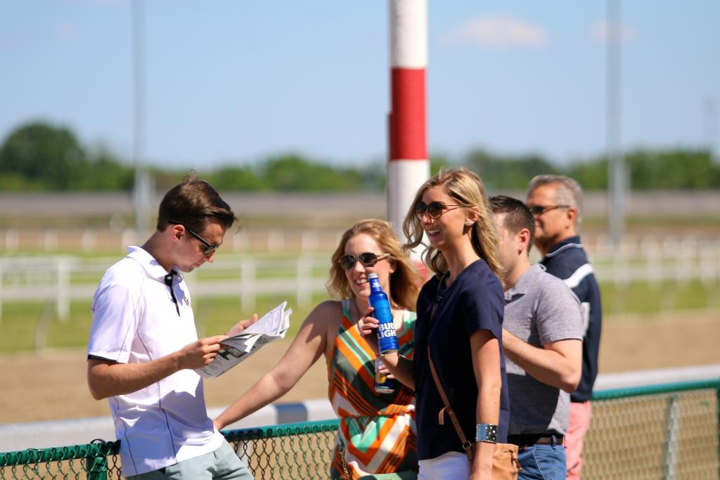 People arrived in droves for Penn Mile day, with groups of friends gathering to enjoy the perfect early-summer weather, a few drinks, and a great day of playing the ponies. (Penelope P. Miller/America's Best Racing)