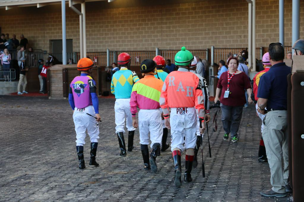 Then the jockeys emerged in a torrent of bright silk colors and made their way to their horses, which meant one thing: it was almost time for the Penn Mile! (Penelope P. Miller/America's Best Racing)