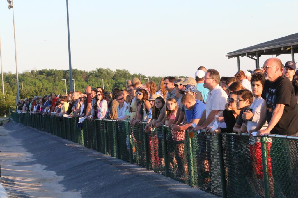 As I made my way to the track, fans were pressed up against the fence lining the grandstand apron, making sure that they had the best possible view of the turf course before the Penn Mile began. (Penelope P. Miller/America's Best Racing)
