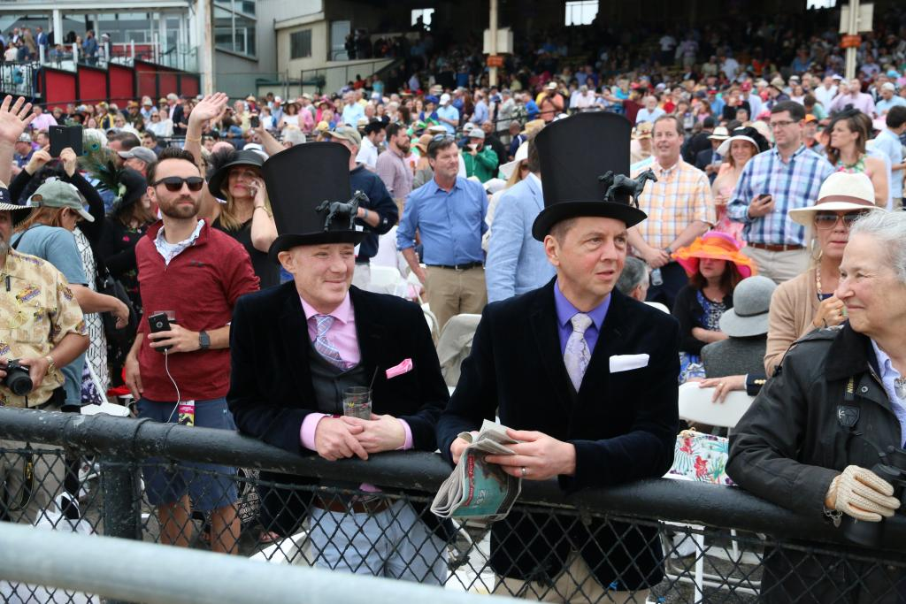 As I walked on the track on the way toward the finish line, I saw these dapper gentlemen rocking some serious Preakness fashion. Check out the tiny horses on their hats! (Penelope P. Miller/America's Best Racing)