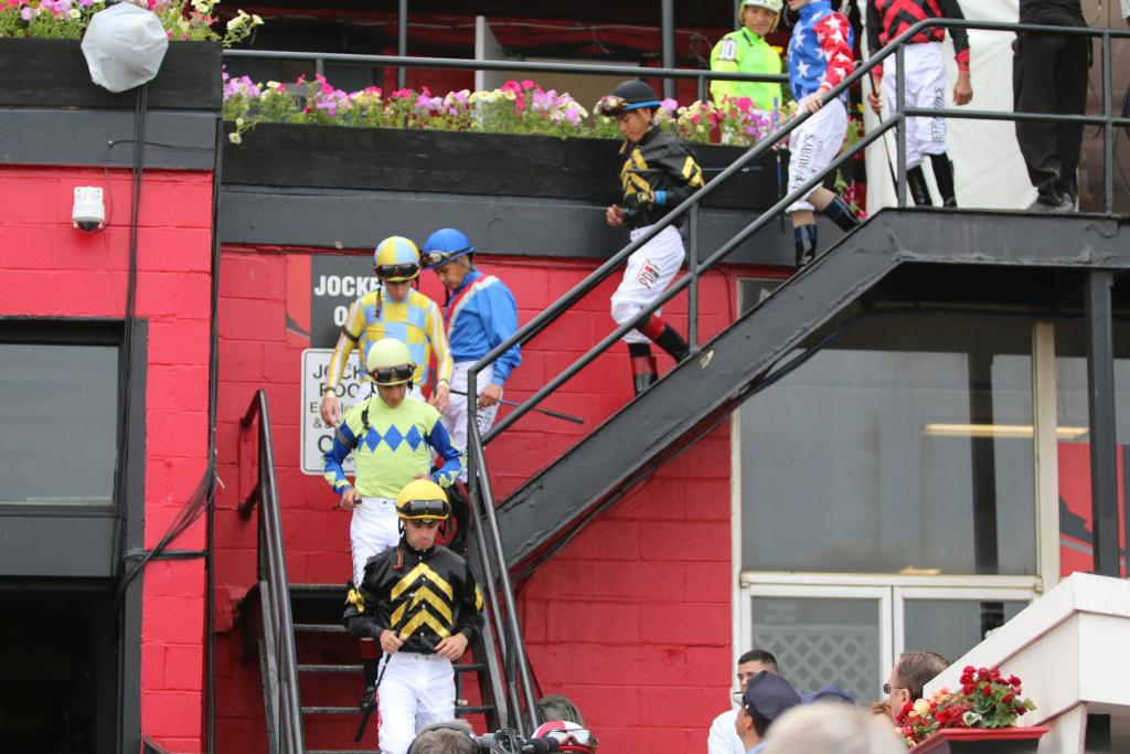 As the horses headed in to the saddling area to prepare for the race, the Preakness jockeys made their way down the stairs toward their mounts. (Penelope P. Miller/America's Best Racing)