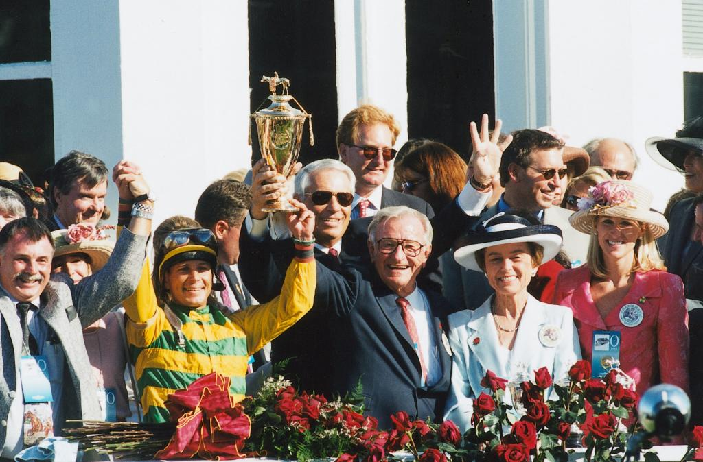 Chris Antley, second from left, after winning the 1999 Kentucky Derby with trainer D. Wayne Lukas and owners Bob and Beverly Lewis. (Anne Eberhardt/Blood-Horse)