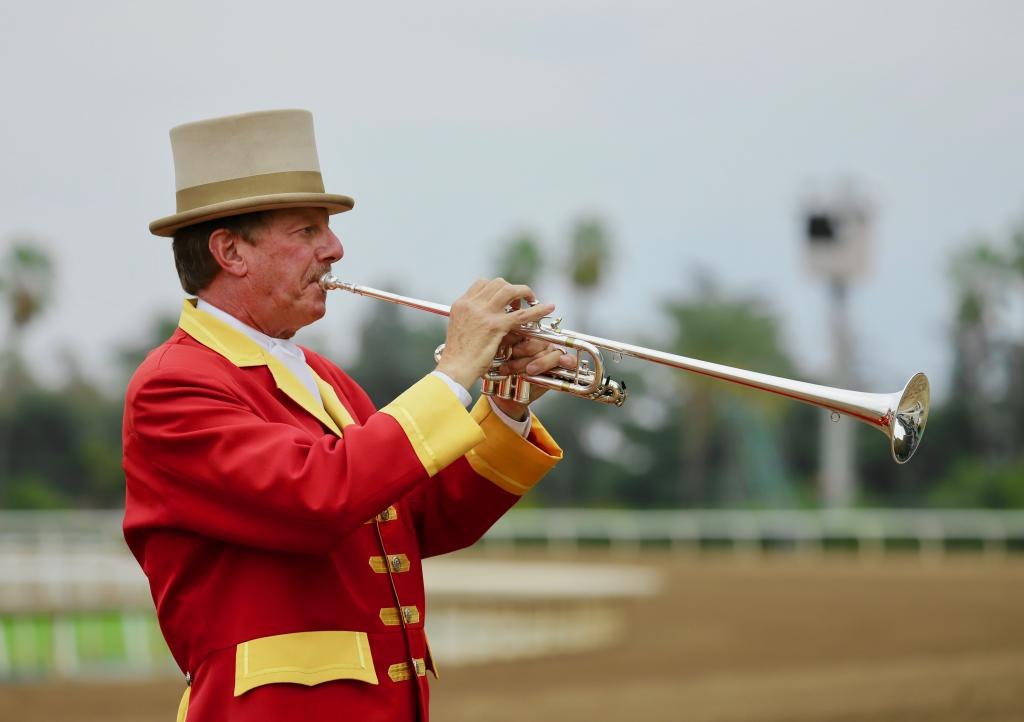 Santa Anita Park's talented bugler Jay Cohen summons the horses to the racetrack. (Penelope P. Miller/America's Best Racing)