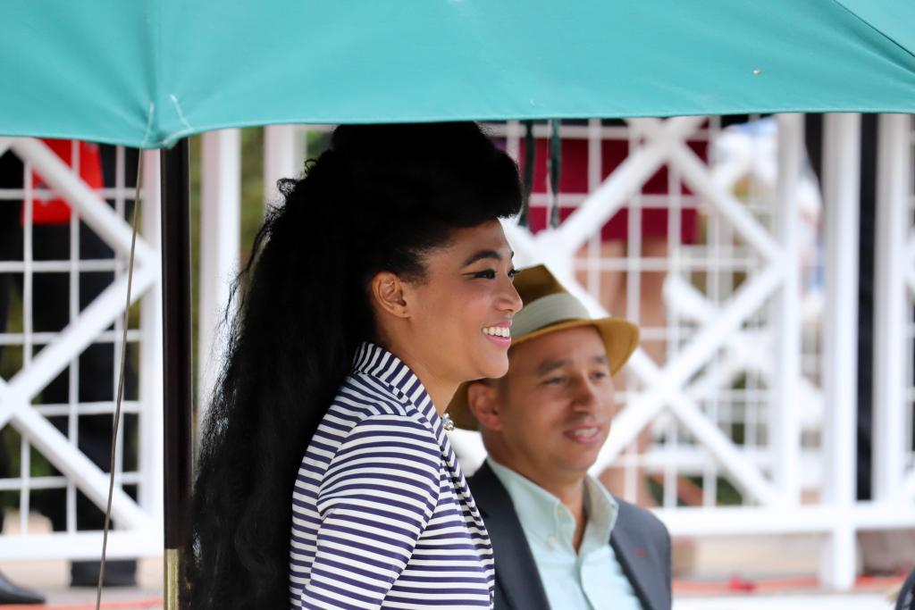 Vocalist Judith Hill watches the Super Saturday racing at Santa Anita Park. (Penelope P. Miller/America's Best Racing)