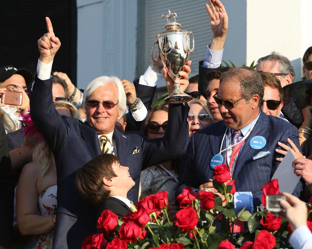Baffert celebrating American Pharoah's 2015 Kentucky Derby win with his son, Bode, and the Zayat family. (Eclipse Sportswire)