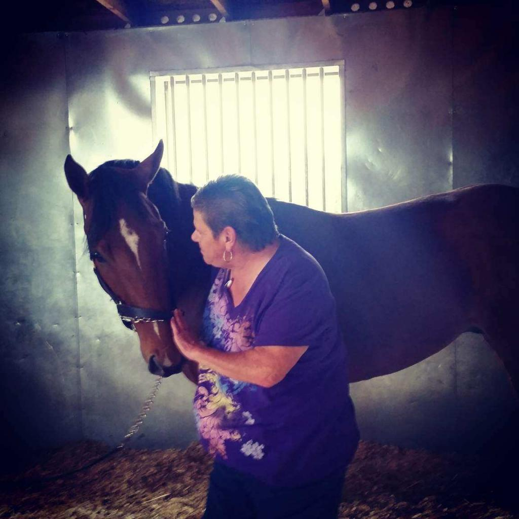 Loving moment between Bruiser and Horse Haven Farm Manager Carrie Drake. (Courtesy of Carrie Drake/Horse Haven)