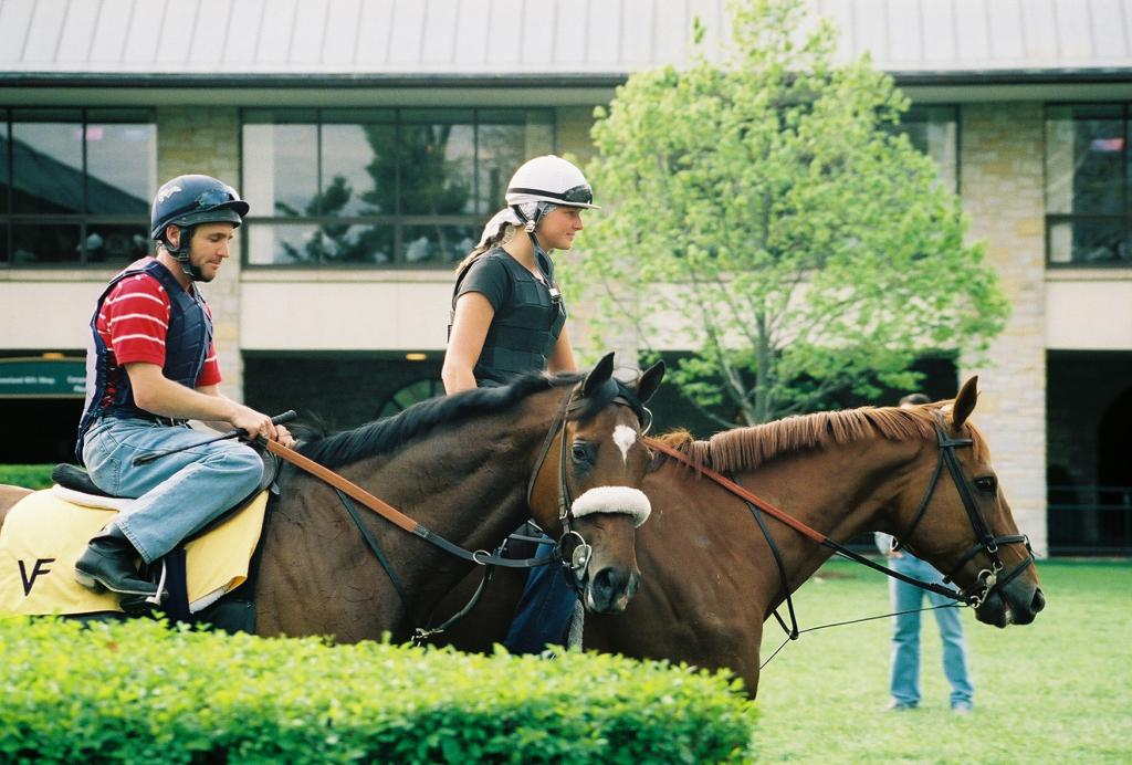 Barbaro, with assistant trainer Peter Brette aboard, schooling in the Keeneland paddock. (Carrie Curry photo)