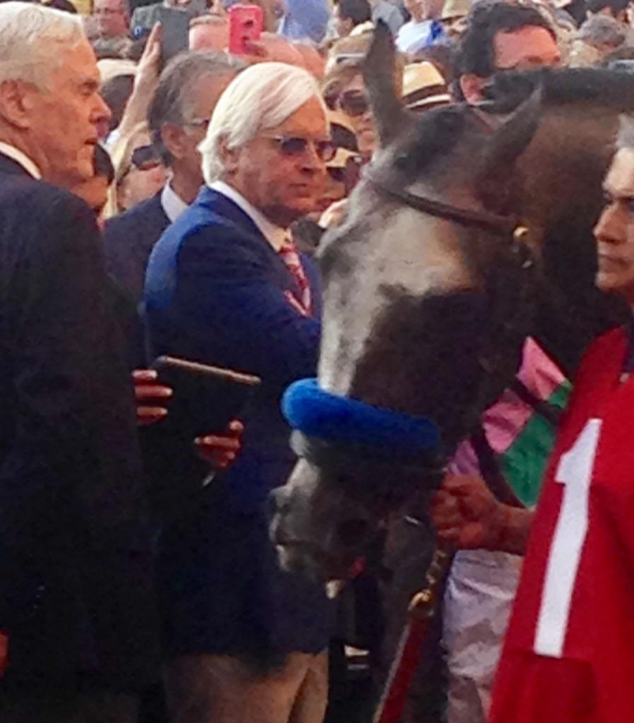 Bob Baffert keeps a close eye on Arrogate in the walking ring. (Courtesy Diane Salek)