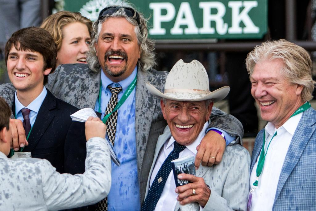 Trainer Steve Asmussen celebrates with family and friends. (Eclipse Sportswire)
