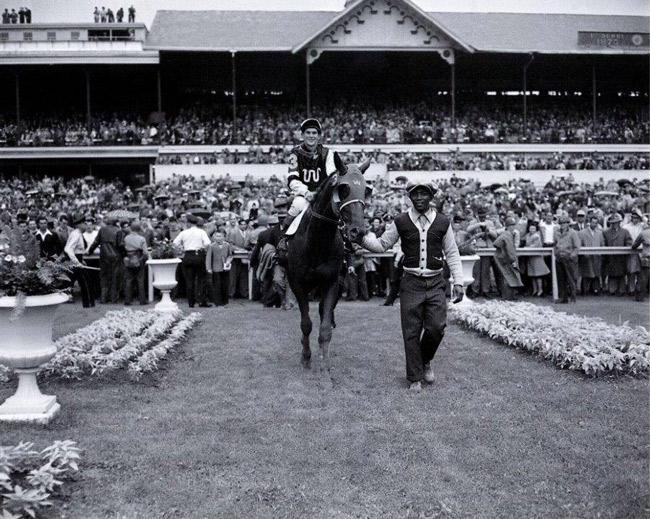 Assault is led into the winner's circle after winning the Kentucky Derby. (Keeneland Library)
