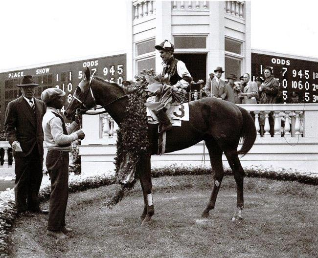 Assault in the winner's circle after winning the Kentucky Derby. (Keeneland Library)