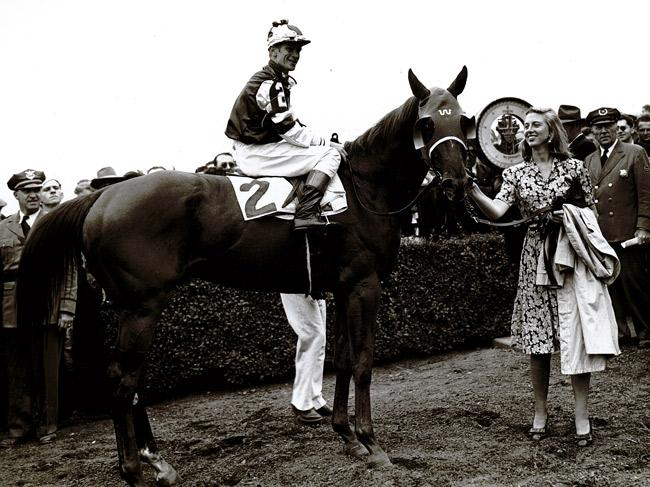 Assault with Helenita Kleberg holding him after winning the Belmont Stakes. (Keeneland Library)