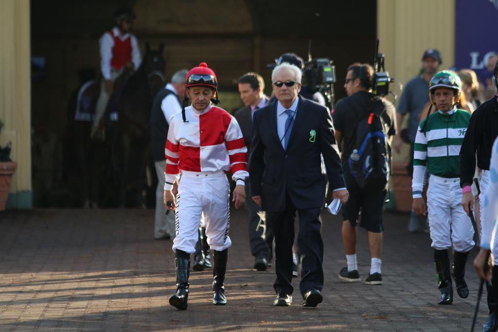 As the horses were saddled in the enclosure near the paddock, the Distaff jockeys emerged. Songbird's rider, Mike Smith, walked with Hall of Fame trainer Jerry Hollendorfer talking prerace strategy. (Penelope P. Miller/America's Best Racing)