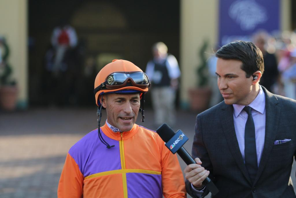 Beholder's jockey, Gary Stevens, walked out with NBC's Laffit Pincay III, giving a prerace interview about the final race of the mega-mare's career. (Penelope P. Miller/America's Best Racing)