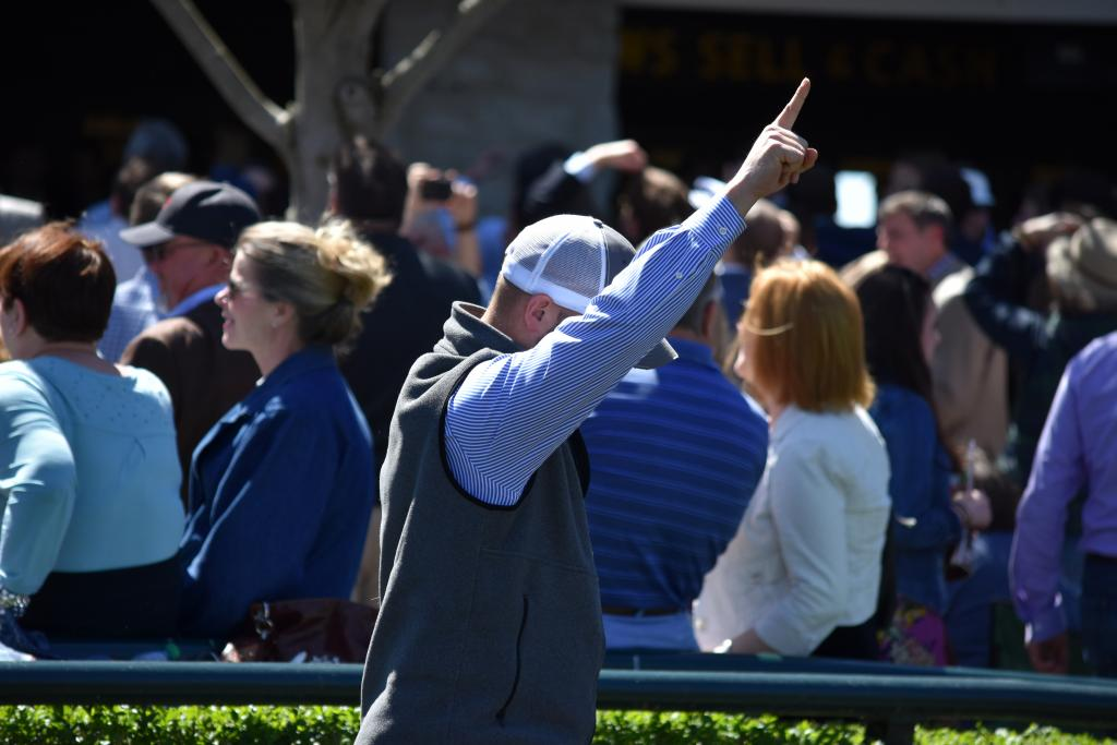 Some horsemen also decide to watch the race from the paddock instead of going up to the track, and in this case, everyone was able to enjoy a winning reaction when this man's horse won. (Melissa Bauer-Herzog/America's Best Racing)