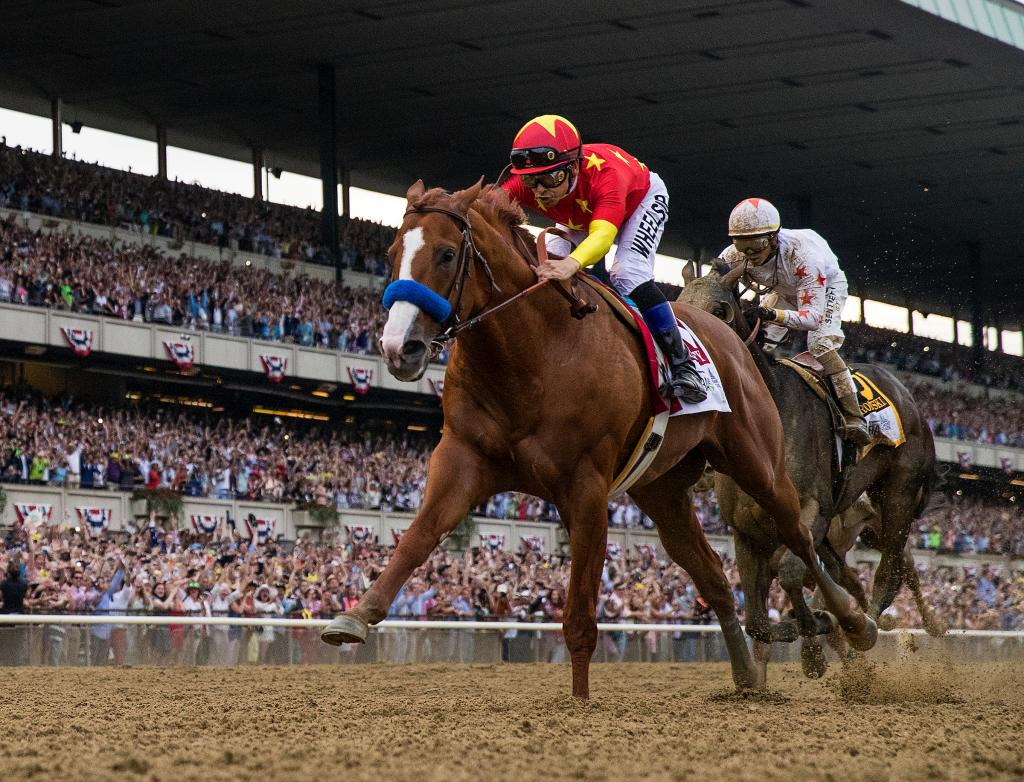 Justify crosses the wire in front to become racing's 13th Triple Crown winner. (Eclipse Sportswire)
