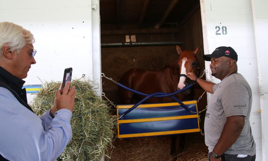 Hall of Fame trainer Bob Baffert take a photo of Chris Gordon with Justify. (Julie June Stewart photo)