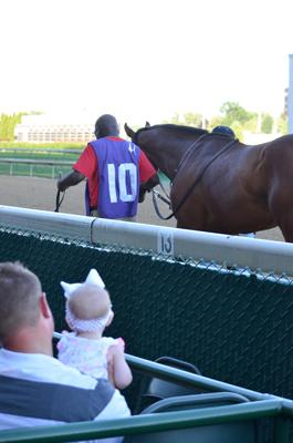 Even the littlest fans were all dressed up as they watched the racehorses.  (Melissa Bauer-Herzog/America's Best Racing)