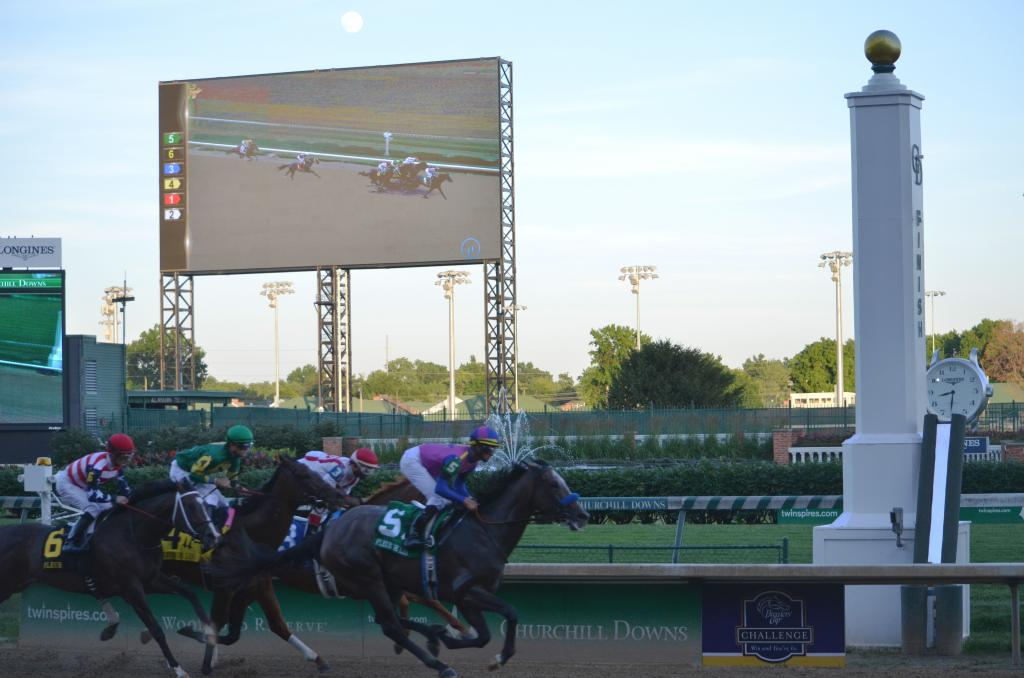 "The first time by the finish line, Big Book led the field under a nearly full moon that had been hidden by the ""Big Board"" in previous races. (Melissa Bauer-Herzog/America's Best Racing)"