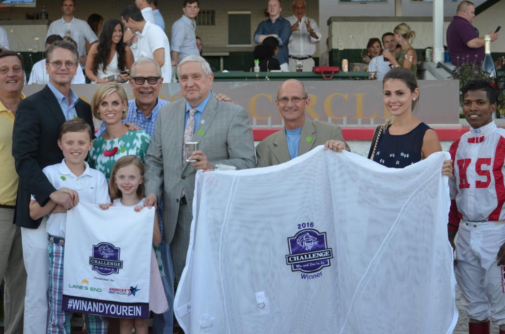 """In addition to the hardware that comes with winning the Fleur de Lis, Paid Up Subscriber's connections earned a lot of Breeders' Cup """"Win and You're In"""" swag. (Melissa Bauer-Herzog/America's Best Racing)"""