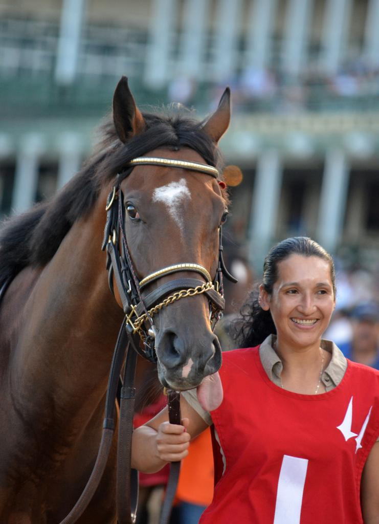 Thatcher Street and his groom looked thrilled to be walking over with a Breeders' Cup winner. (Melissa Bauer-Herzog/America's Best Racing)