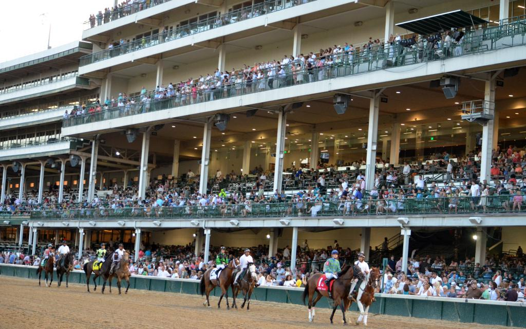 There was a big crowd on hand as the Wise Dan field paraded in front of the stands before the turf race. (Melissa Bauer-Herzog/America's Best Racing)