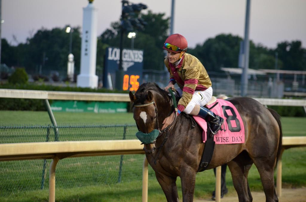 When Pleuven and Channing Hill returned to the winner's circle, he got a big pat from his jockey … (Melissa Bauer-Herzog/America's Best Racing)