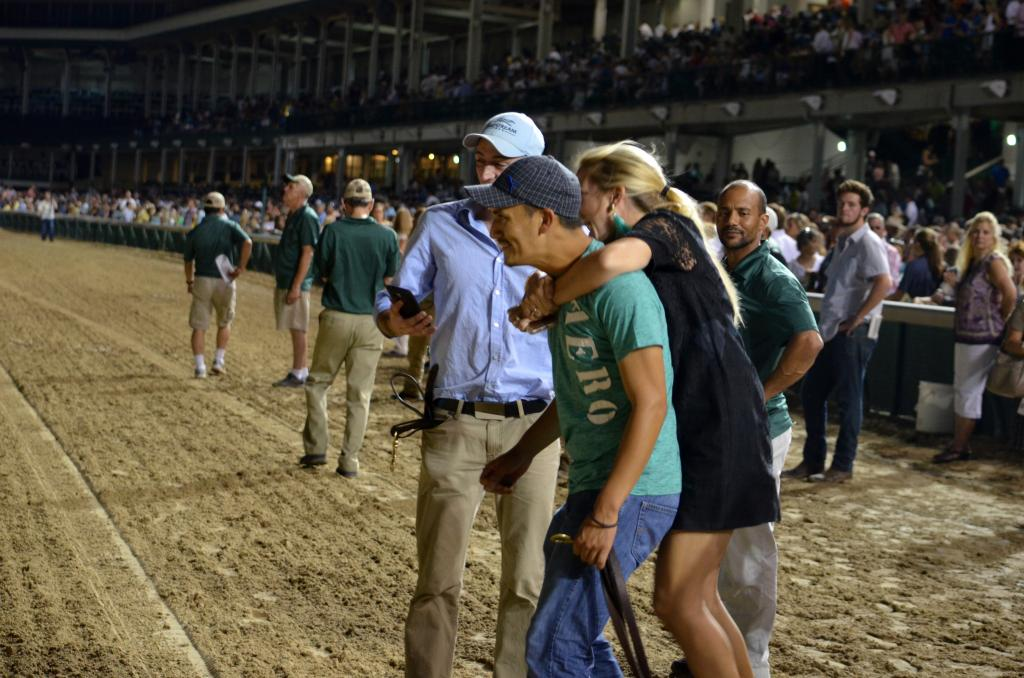 A popular horse in trainer Eddie Kenneally's barn, his staff celebrated the win while waiting for Bradester to come back. (Melissa Bauer-Herzog/America's Best Racing)