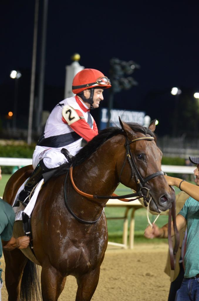 When jockey Joe Bravo and Bradester returned, Bravo was eager to praise the horse and said Bradester reminded him of his Grade 1 winning sire, Lion Heart, who Bravo had ridden. (Melissa Bauer-Herzog/America's Best Racing)