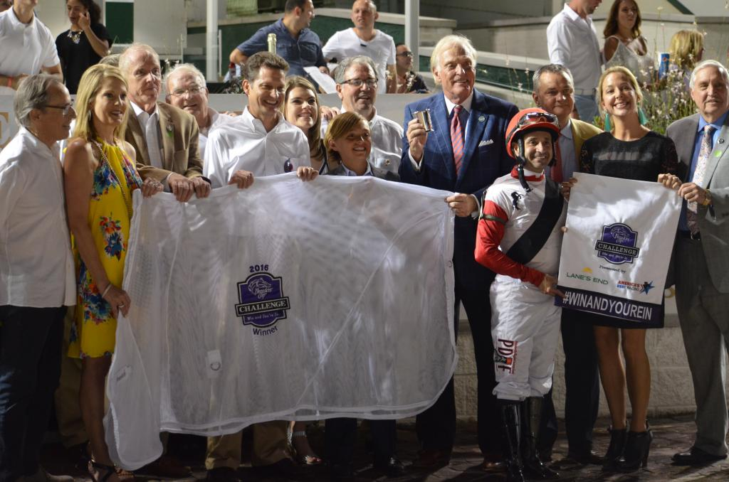 The victory secured Bradester a spot in the November Breeders' Cup Classic and his connections posed with his prizes for the win.