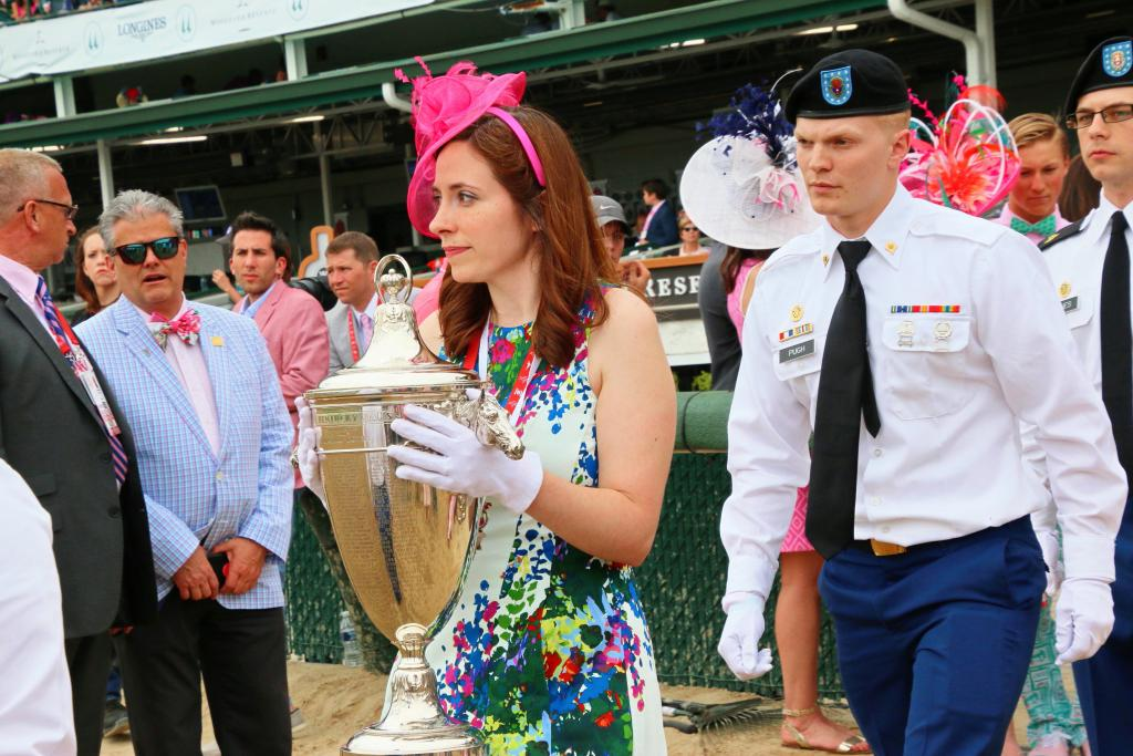 Caroline Collins carries the beautiful Kentucky Oaks trophy to the winner's circle. (Julie June Stewart photo)