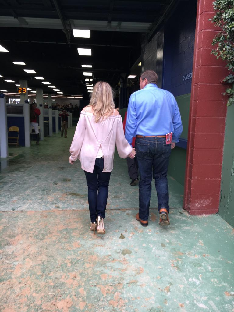 Sara and her husband, Casey, at the racetrack. (Courtesy of Sara Dacus)