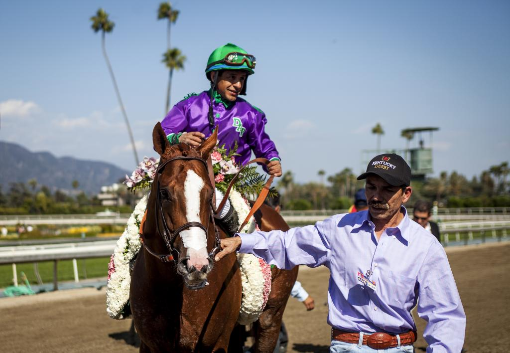 California Chrome, Victor Espinoza and groom Raul Rodriguez after the 2014 Santa Anita Derby. (Eclipse Sportswire)