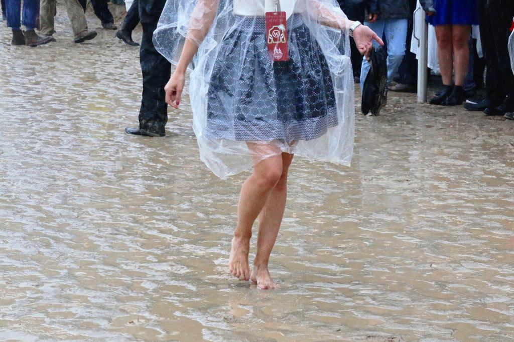 Dancing in the rain on the Churchill Downs track. (Julie June Stewart photo)
