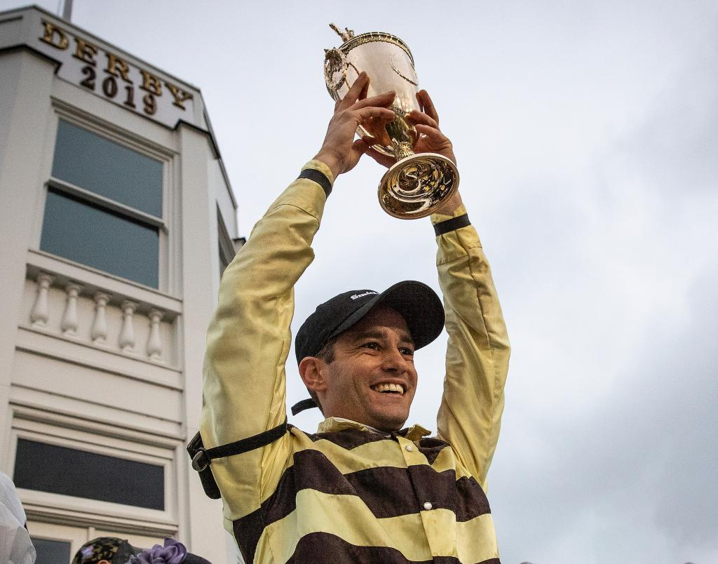 Prat hoists the Derby trophy. (Eclipse Sportswire)