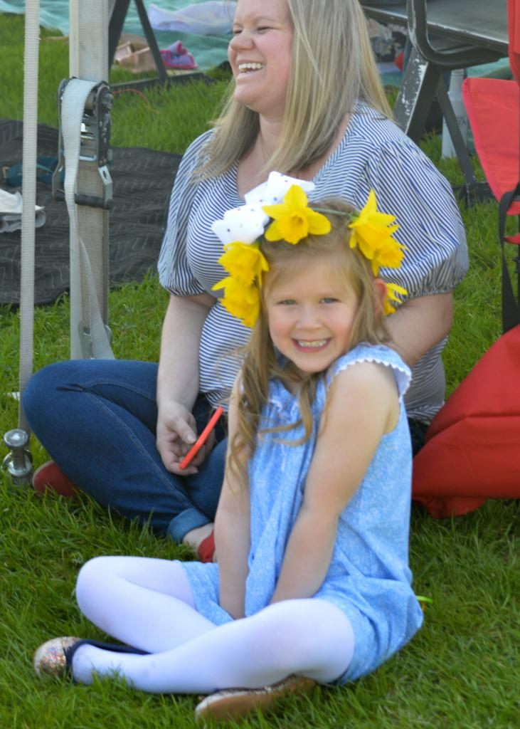 A young fan from the infield sported gorgeous daffodil headwear. (Sara Dacus photo)