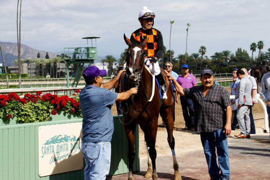 In the winner's circle with Shirreffs' assistant, Frank Leal, on the right. (Cynthia Holt photo)